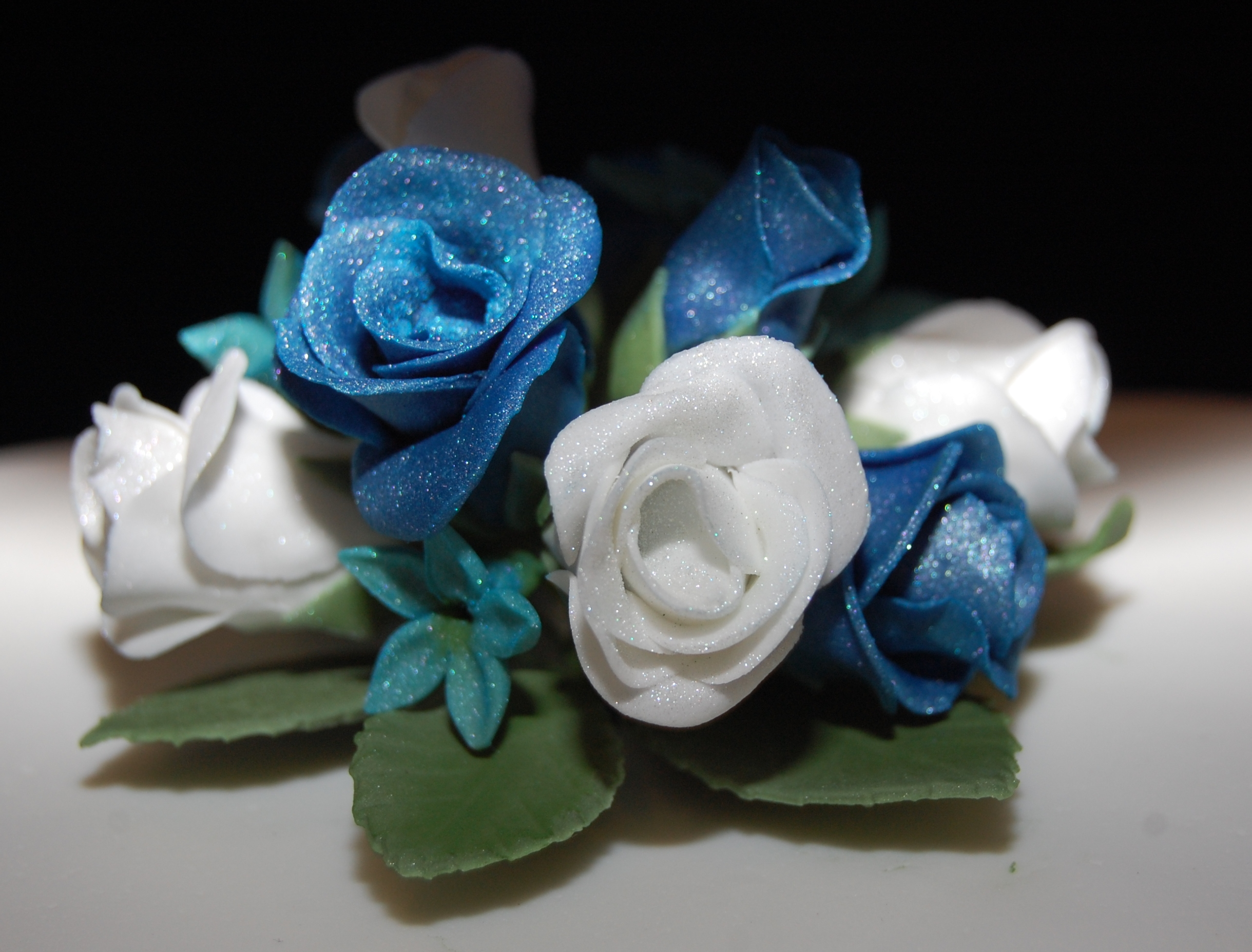 3 Tier Heart Shaped Wedding Cake With Royal Blue And Turquoise Roses