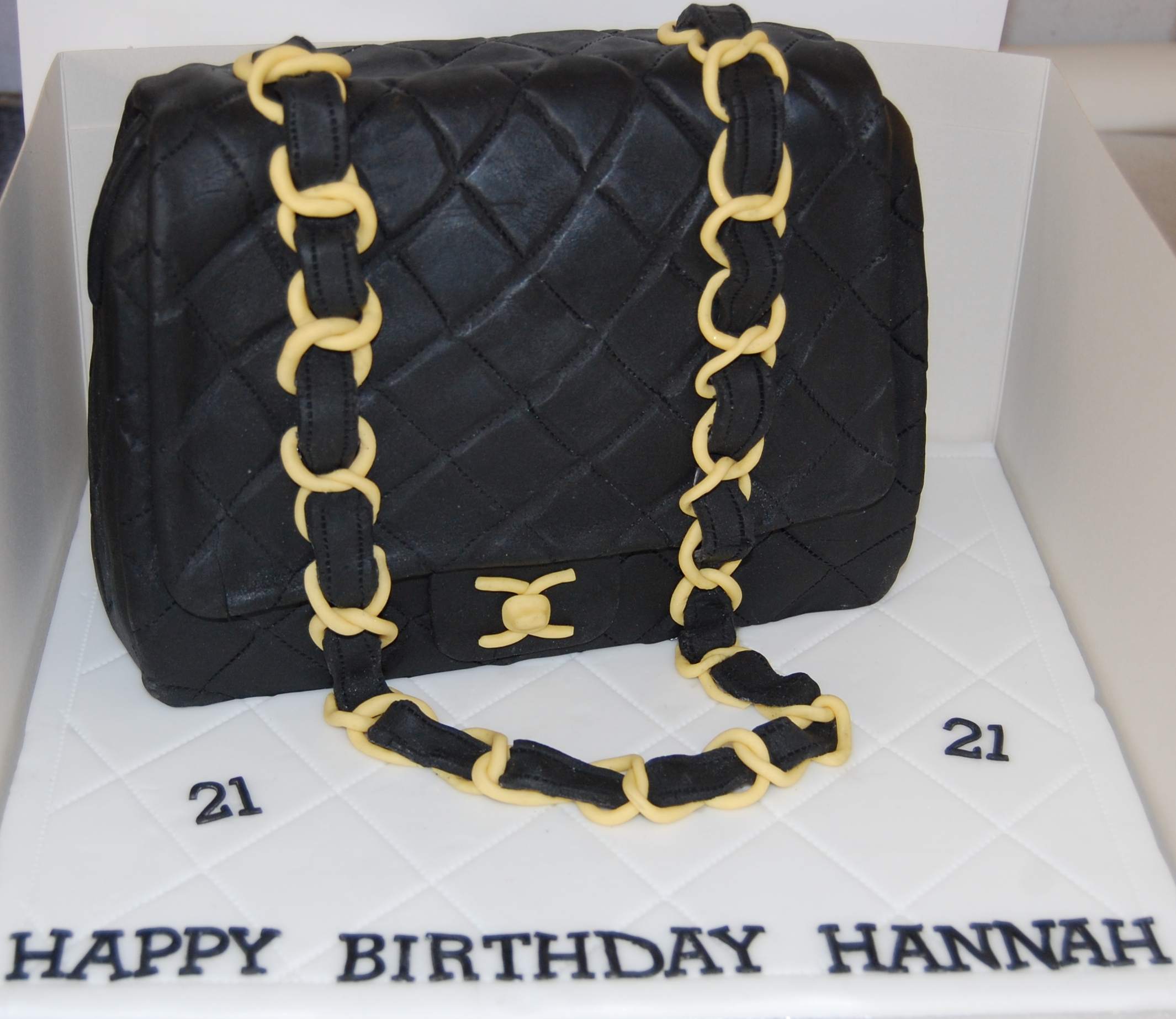 ae7c6707ecb2 Chanel bag birthday cake with the classic black and gold strap – it ...