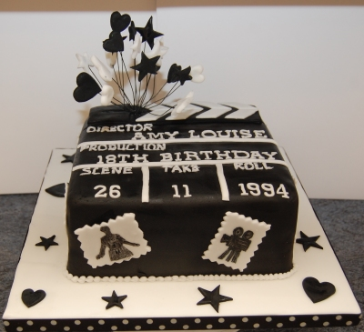 Amys 18th birthday cake clapperboard black and white icing stars hearts and move theme (2)