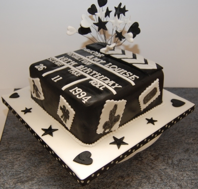 Amys 18th birthday cake clapperboard black and white icing stars hearts and move theme (3)
