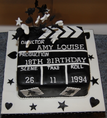 Amys 18th birthday cake clapperboard black and white icing stars hearts and move theme