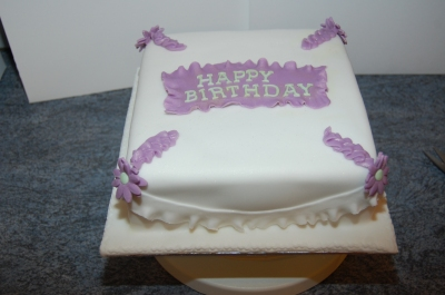 nans birthday cake puple and white daisys and frills  (2)