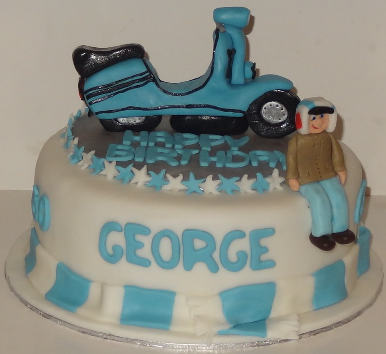 Georges 60th cake 1 scooter and george everton colours
