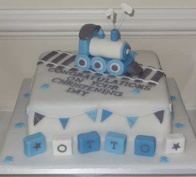 Blue christening cake with train topper