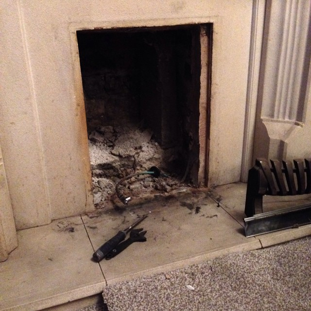 Fireplace being cleaned out